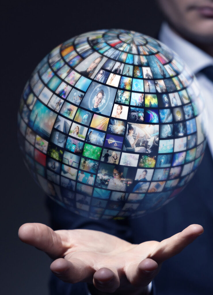 man holding a globe made of computer screens
